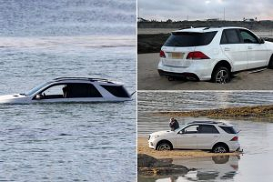Mercedes submerged by tide after getting stuck on north